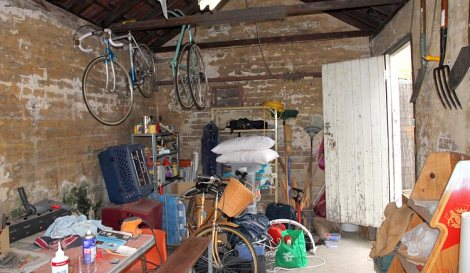 Dirty untidy garage full of stuff