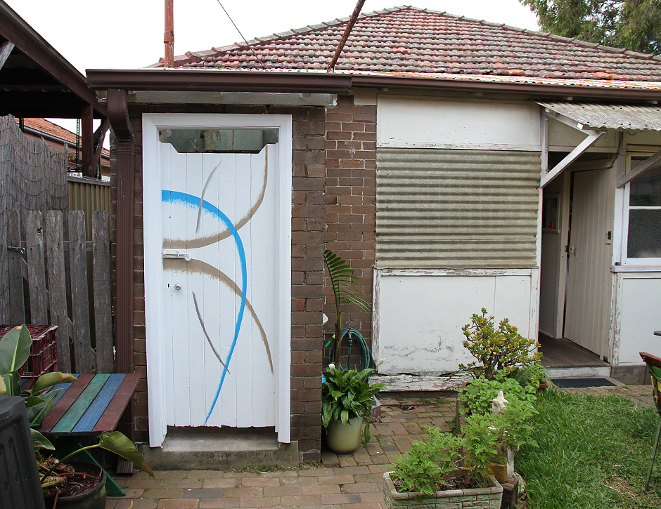 "Elizabeth Pulie,"" #24 (Toilet Door)"" (installation) 2013 Acrylic paint on wood"