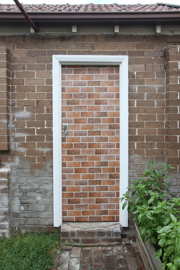 "Jane Polkinghorne: ""I'm a Brick House"", 2013, wallpaper on wooden door"