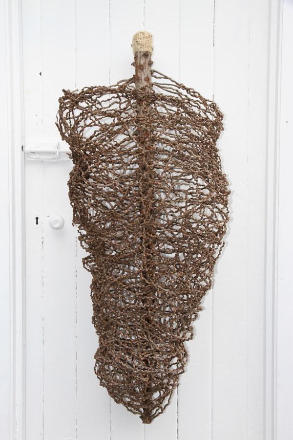 "Penny Polkinghorne: ""Home 1"" 2013, random weaving in Cocos palm inflorescence, sisal string, 115 x 46 x 90 cm"