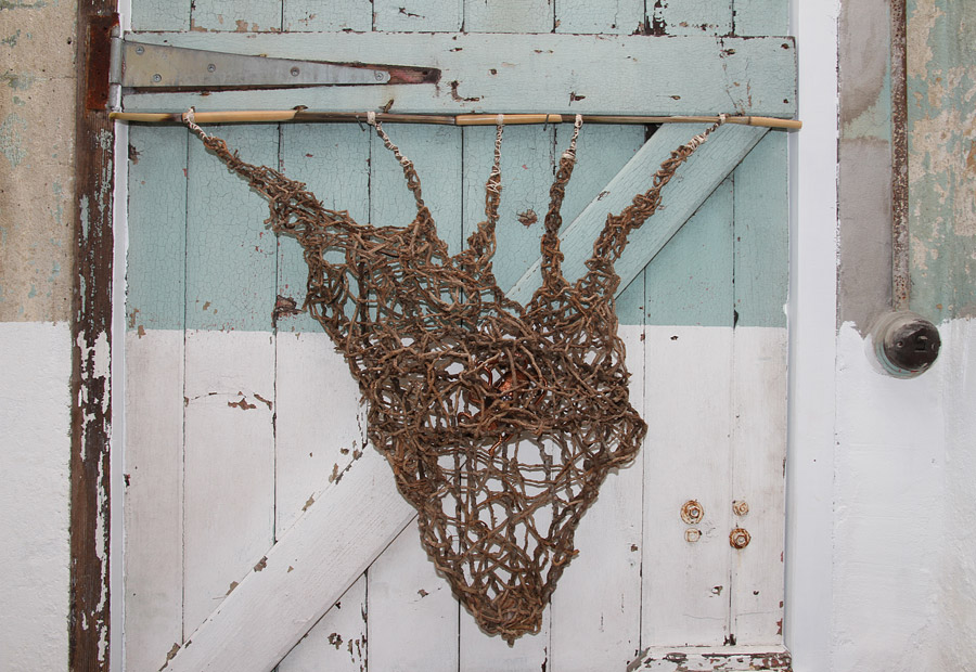 """Penny Polkinghorne: """"What a tangled web"""", 2013, Random weaving with Bangalow palm, bamboo, linen thread and copper, 56 x55 cm"""