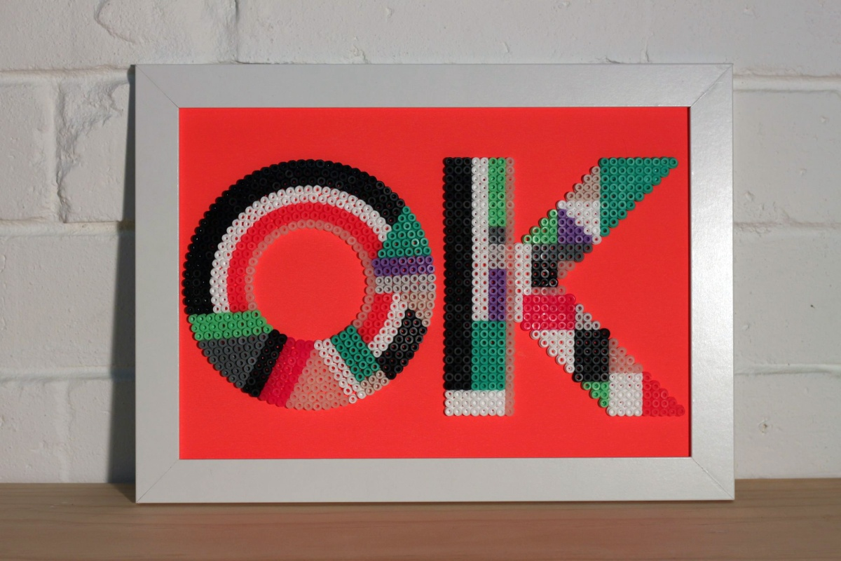 Liane Rossler OK, 2013 Fused plastic beads on card 33.5 x 24.5cm