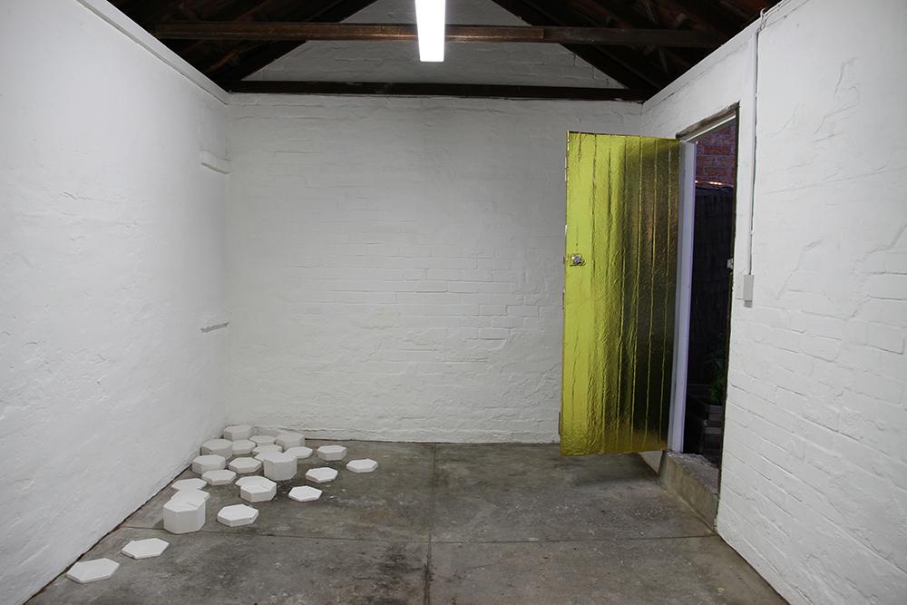 Bridget Minatel: Code, installation view, 2013. Geo-metric (2013), plaster of paris, dimensions variable.
