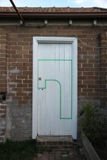 Margaret Roberts: Architectural Composition with Backyard, 2013, garage door. Masking tape on wooden doors