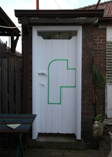 Margaret Roberts: Architectural Composition with Backyard, 2013. Masking tape on wooden doors