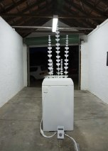 Josie Cavallaro: Spin, 2013. Washing machine, champagne glasses, sound, paper