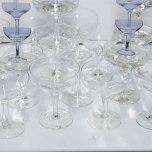 Josie Cavallaro: Spin, 2013. Washing machine, champagne glasses, sound, paper