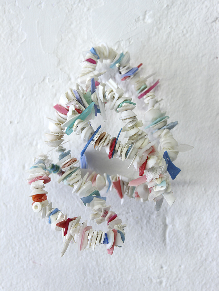 Rox de Luca: Saved Bundles I- V, 2014. found plastics, wire
